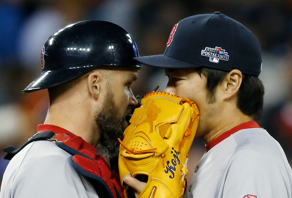 . Boston Red Sox\'s David Ross, left, talks to Koji Uehara in the eighth inning during Game 5 of the American League baseball championship series against the Detroit Tigers, Thursday, Oct. 17, 2013, in Detroit. (AP Photo/Paul Sancya)
