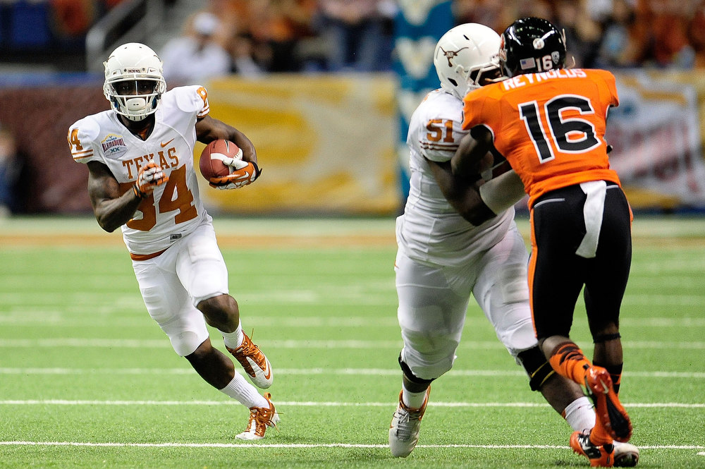 . Marquise Goodwin #84 of the University of Texas Longhorns runs for a long touchdown against the Oregon State Beavers during the Valero Alamo Bowl at the Alamodome on December 29, 2012 in San Antonio, Texas.  (Photo by Stacy Revere/Getty Images)