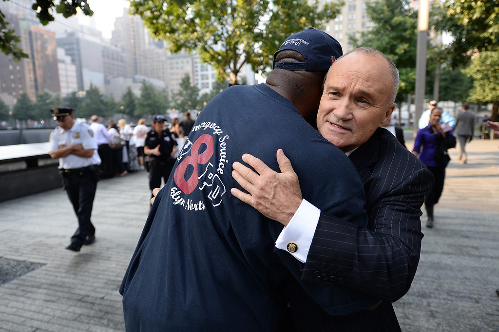 . New York City Police Commissioner Ray Kelly (R) hugs a friend at the South Tower reflecting pool of the 9/11 Memorial during ceremonies for the twelfth anniversary of the terrorist attacks on lower Manhattan at the World Trade Center site on September 11, 2013 in New York City. (Photo by Stan Honda-Pool/Getty Images)