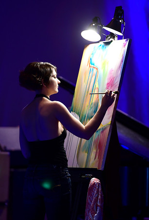 3/30/2019 Mike Orazzi | Staff Kerry Kennedy live paints on the main stage during Swan Day CT held at Trinity on Main in New Britain Saturday night.