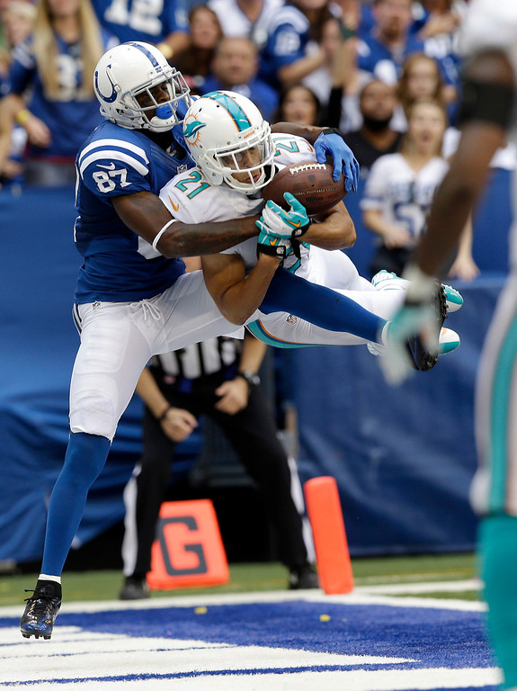 . Miami Dolphins\' Brent Grimes (21) intercepts a pass in the end zone intended for Indianapolis Colts\' Reggie Wayne (87) during the second half an NFL football game Sunday, Sept. 15, 2013, in Indianapolis. (AP Photo/Michael Conroy)