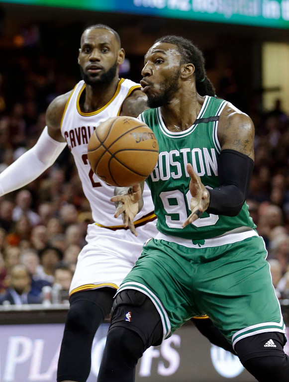 . Boston Celtics\' Jae Crowder (99) passes against Cleveland Cavaliers\' LeBron James (23) during the first half of Game 3 of the NBA basketball Eastern Conference finals, Sunday, May 21, 2017, in Cleveland. (AP Photo/Tony Dejak)
