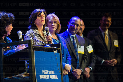 Outstanding Voices recipient Jennifer Cast, vice president, Amazon Books at Amazon.com, speaks as other Outstanding Voices honorees listen during the Puget Sound Business Journal's The Business Of Pride at the Paramount Theatre in Seattle on Thursday, May 26, 2016. (BUSINESS JOURNAL PHOTO | Dan DeLong)
