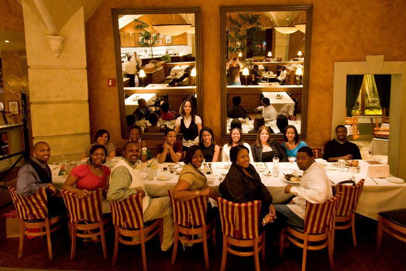 "Restaurant ""Hey would guys like me to take your picture?  I'll email it to you.""  After this shot they asked me for my business card and prices.  ""Sorry, I'm from out of town on a business trip."" - Buckhead, Georgia - April 2008 - You can see me in the mirror.  First time I made good use of the Live View (being able to preview the shot in the LCD. Yeah, it was a novelty back then.)"