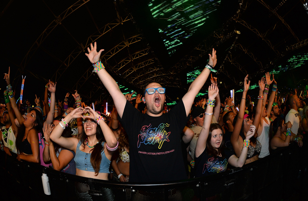 . Chris Felt (C) of Michigan reacts during a performance by DJs AN21 and Max Vangeli at the 17th annual Electric Daisy Carnival at Las Vegas Motor Speedway on June 23, 2013 in Las Vegas, Nevada.  (Photo by Ethan Miller/Getty Images)