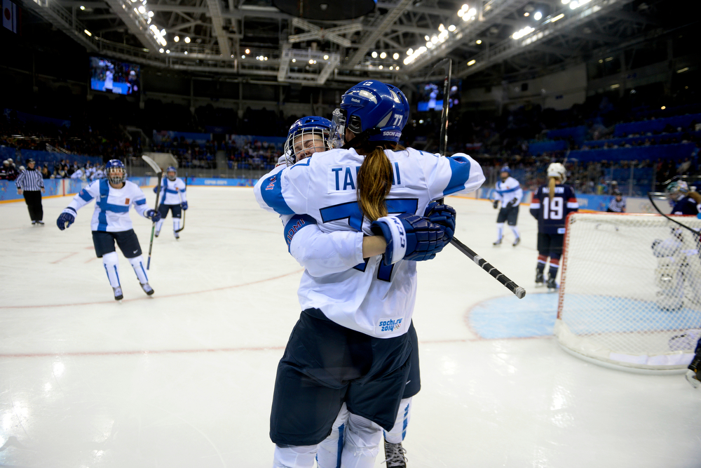 . Finland\'s Susanna Tapani (77) celebrates her goal with teammate Minttu Tuominen during the third period of the United States\' 3-1 win against Finland. Sochi 2014 Winter Olympics on Saturday, February 8, 2014. (Photo by AAron Ontiveroz/The Denver Post)