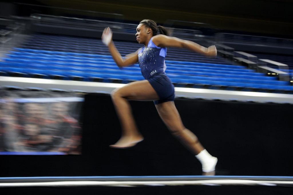 . UCLA\'s Olivia Courtney practices the vault. (Michael Owen Baker/Staff Photographer)
