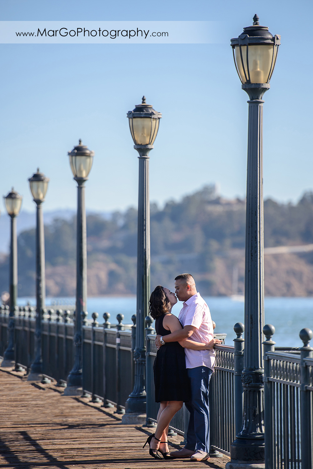 engagement session at Pier 7 in San Francisco - kissing couple