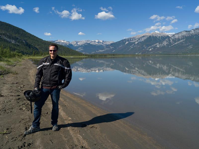 Tourist standing at lakeside, Jasper Lake, Yellowhead Highway, Jasper National Park, Jasper, Alberta, Canada