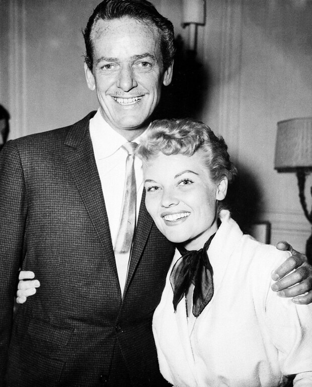 . Singer Patti Page, right, and her husband, choreographer Charles O\'Curran, are shown at a press reception at the Savoy Hotel in London, England, July 10, 1957.  (AP Photo)