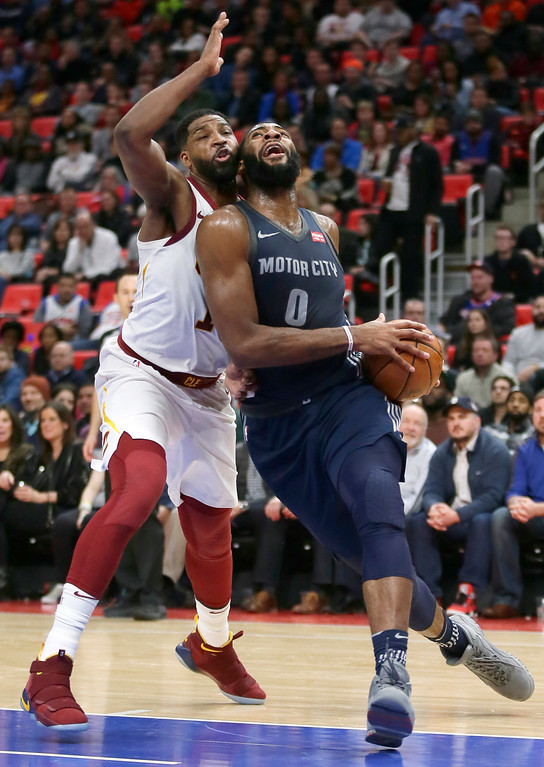 . Detroit Pistons center Andre Drummond (0) goes to the basket past Cleveland Cavaliers center Tristan Thompson, left, during the first half of an NBA basketball game Tuesday, Jan. 30, 2018, in Detroit. (AP Photo/Duane Burleson)
