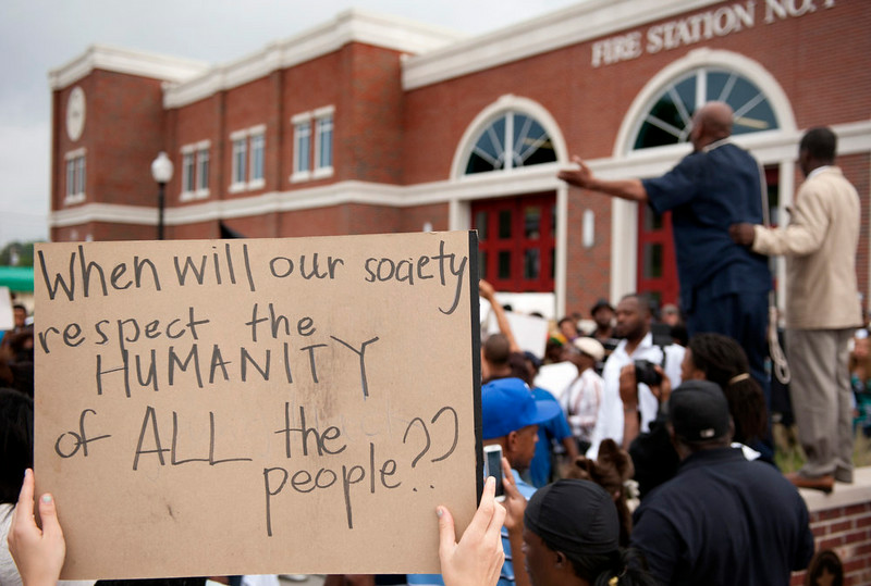 . Protestors rally Sunday, Aug. 10, 2014 to protest the shooting of Michael Brown, 18, by police in Ferguson, Mo.  Saturday, Aug. 9, 2014. Brown died following a confrontation with police, according to St. Louis County Police Chief Jon Belmar, who spoke at a press conference Sunday. The protesters rallied in front of the police and fire departments in Ferguson following Belmar\'s press conference. (AP Photo/Sid Hastings)