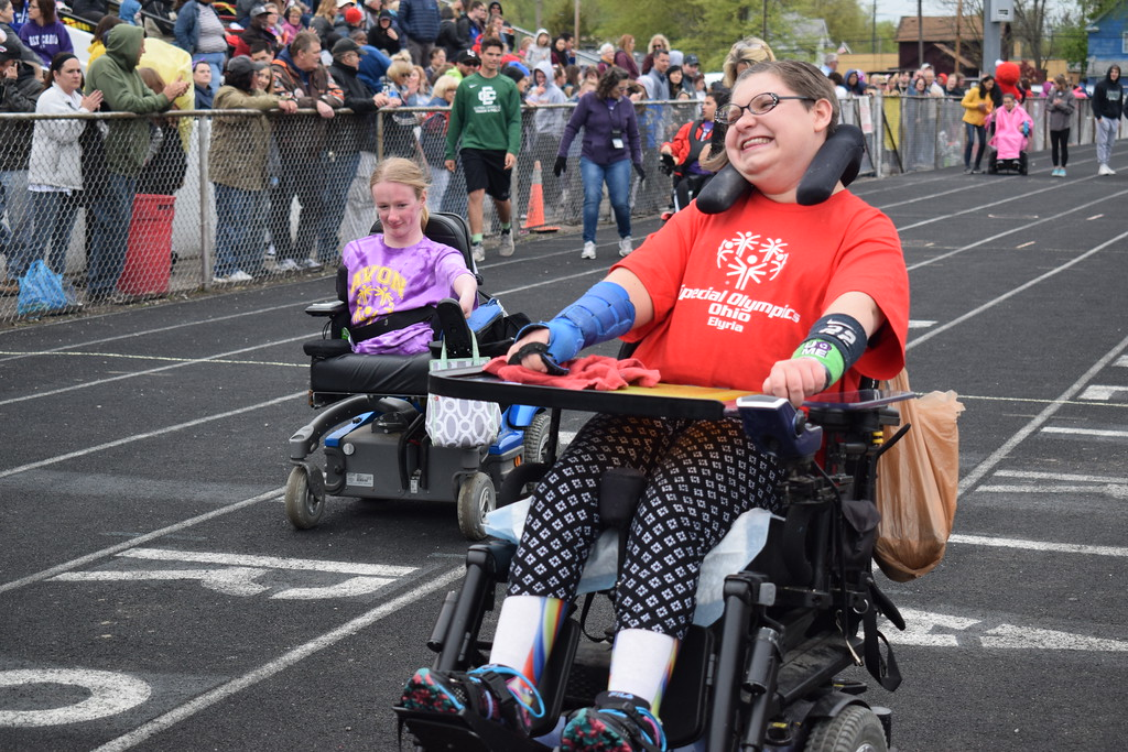 . Briana Contreras � The Morning Journal <br> Elyria High School Junior, Ally Norris races in excitement as she makes it to the finish line of her 25 Meter Wheelchair Race at the 38th Annual Lorain County Special Olympics May 11 at Ely Stadium in Elyria. The event welcomed 601 athletes of 16 different school districts in Lorain County.