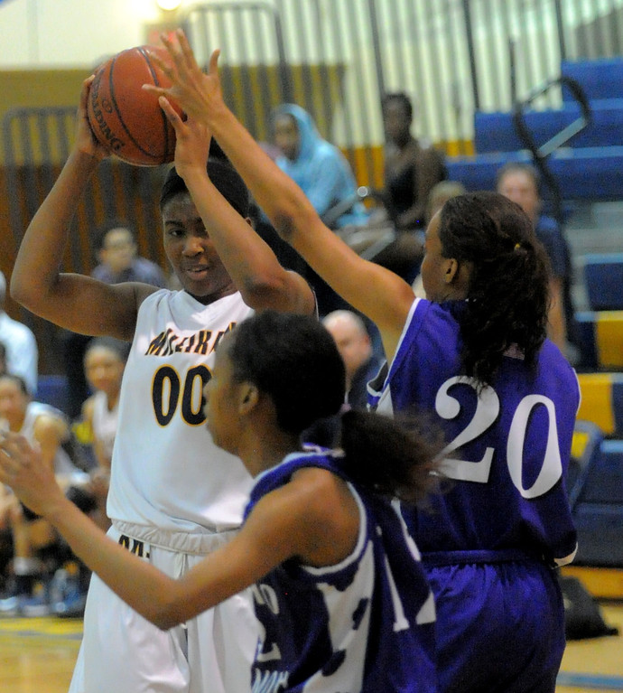 . 02-16-2012--(LANG Staff Photo by Sean Hiller)- Millikan vs. Rancho Cucamonga in Saturday night\'s  first-round CIF girls basketball game at Millikan High School in Long Beach. Rancho\'s Alexis Alexander (20) pressures Dionna Henley (00).