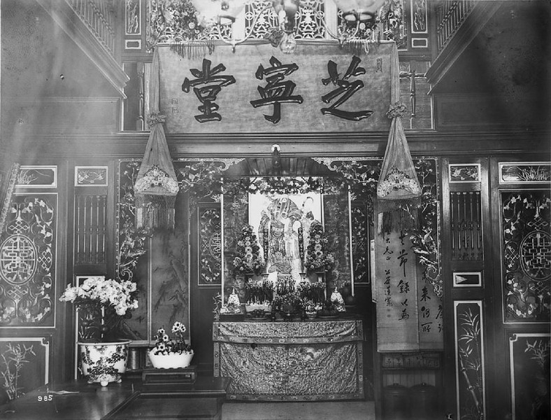Interior of a Chinese store decorated for the New Year's celebration, ca.1900