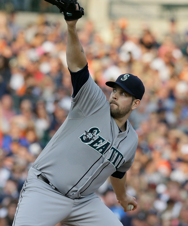 . Seattle Mariners starting pitcher James Paxton throws during the first inning of a baseball game against the Detroit Tigers, Friday, Aug. 15, 2014 in Detroit. (AP Photo/Carlos Osorio)