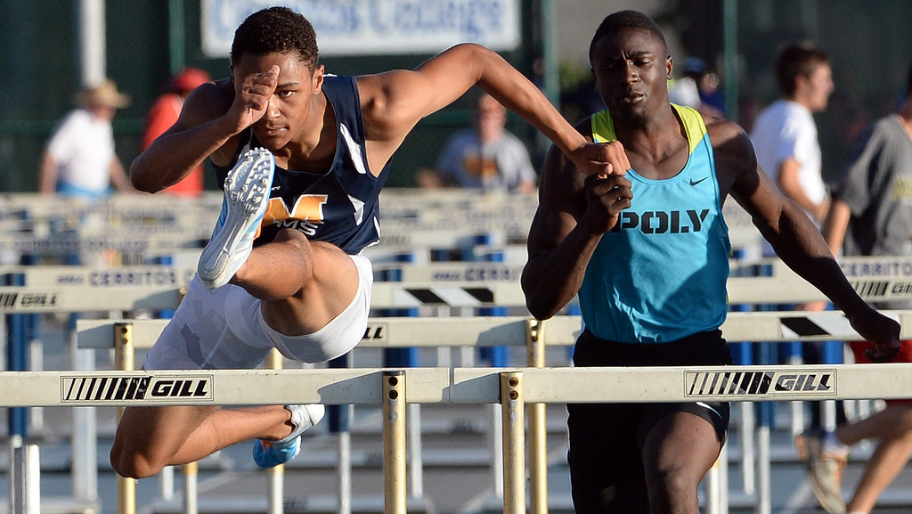 . Millikan\'s Misana Viltz, left, along with Long Beach Poly\'s Juan Ward competes in the 110 meter hurdles during the CIF-SS Masters Track and Field meet at Falcon Field on the campus of Cerritos College in Norwalk, Calif., on Friday, May 30, 2014.   (Keith Birmingham/Pasadena Star-News)