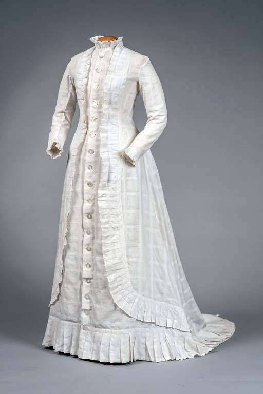 ". This white linen and cotton dress was most likely worn indoors during the hot Washington, D.C., summer by Lucretia Garfield. ""Lucretia\'s Dresses\"" is on display through July 31 at the James A. Garfield National Historic Site in Mentor. For more information, visit <a href=\""https://www.nps.gov/jaga/index.htm\"">nps.gov/jaga/index.htm</a>. (Submitted)"