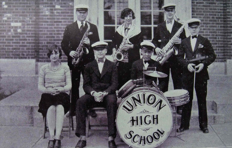 Union High School Jazz Band of 1926. The young woman holding the saxaphone, in the middle top row was the Band Teacher, Miss Virginia Smith. She was the daughter of Charles E. Smith, the Union Tax Assessor, and grand niece of Police Chief Charles Hopkins. The violin player in the lower right is Harold Heuer.
