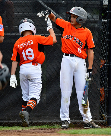 8/6/2019 Mike Orazzi | Staff Pennsylvania's JJ Gossard (19) gets congratualted after scoring by Aaron Angelo (6) after scoring during their second game of the Little League Mid-Atlantic regional on Aug. 6, 2019 at Breen Field in Bristol, Ct.