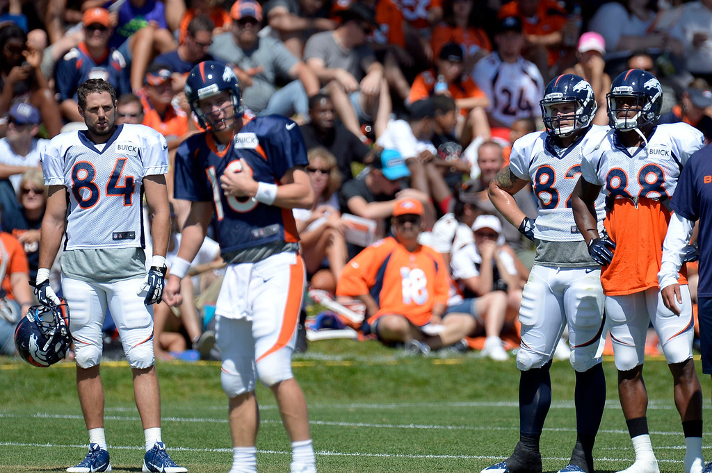 . Denver Broncos TE Jacob Tamme (84) Jake O\'Connell (82) and WR Demaryius Thomas watch QB Peyton Manning (18) run the offense during training camp August 5, 2013 at Dove Valley. (Photo By John Leyba/The Denver Post)