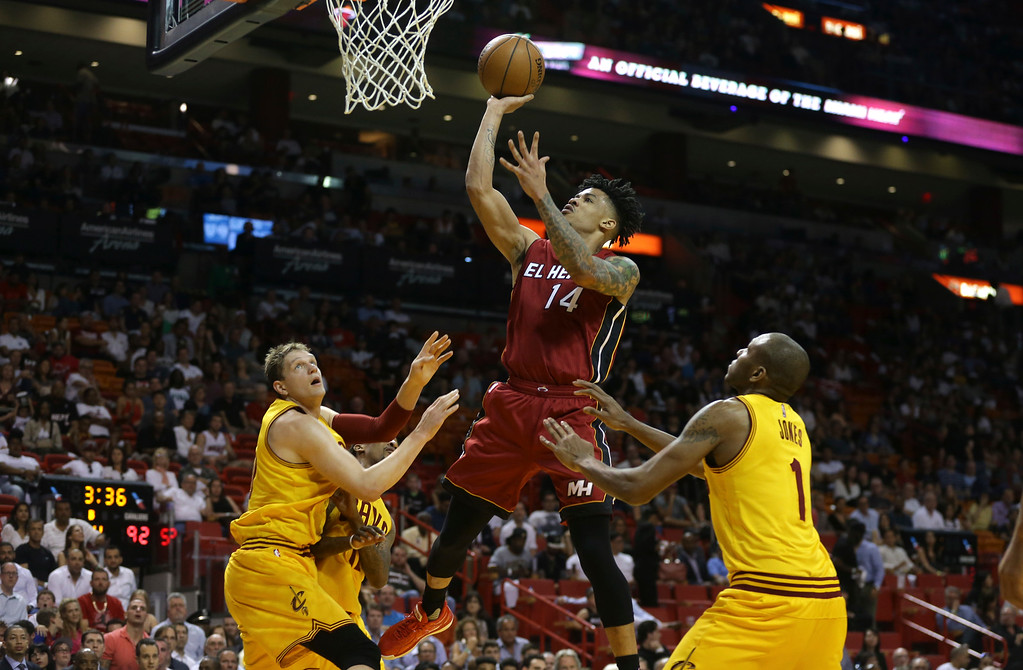 . Miami Heat forward Gerald Green (14) shoots over Cleveland Cavaliers center Timofey Mozgov, left, and guard James Jones (1) during the second half of an NBA basketball game, Saturday, March 19, 2016, in Miami. The Heat defeated the Cavaliers 122-101. (AP Photo/Lynne Sladky)