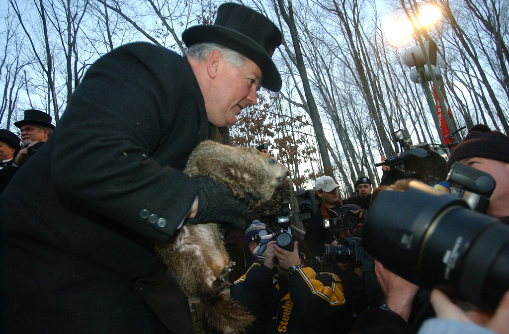 . Handler Bill Deeley holds Punxsutawney Phil, their weather predicting groundhog as he talks with the media after the reading of the proclamation that there would be six more weeks of winter after seeing his shadow in Puxsutawney, Pa. on Wednesday, Feb. 2, 2005  (AP Photo/Keith Srakocic)