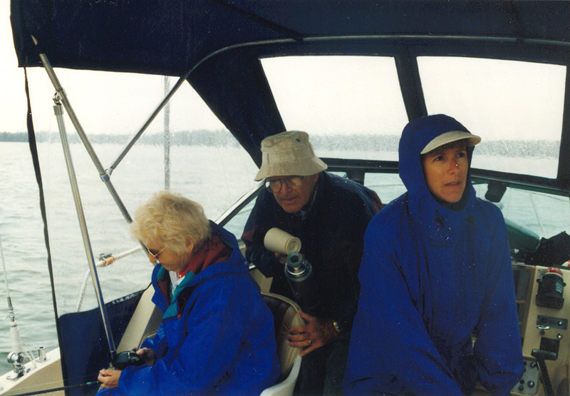 Fishing_in_the_rain_hiding_under_the_cover_1998.jpg