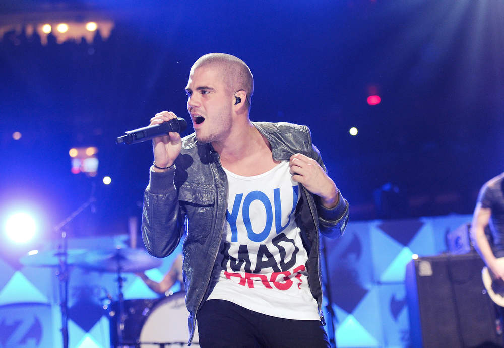 Description of . Singer Max George from The Wanted performs at Z100's Jingle Ball 2012 presented by Aeropostale at Madison Square Garden on Friday Dec. 7, 2012 in New York. (Photo by Evan Agostini/Invision/AP)