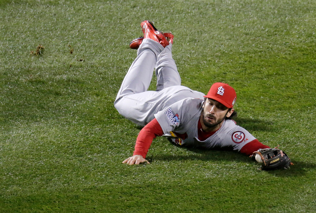 . St. Louis Cardinals\' Matt Carpenter can\'t catch a ball hit by Boston Red Sox\'s David Ortiz during the eighth inning of Game 2 of baseball\'s World Series Thursday, Oct. 24, 2013, in Boston. (AP Photo/Charlie Riedel)