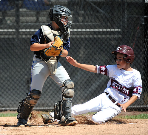 8//8/2019 Mike Orazzi | Staff New Hampshire Goffstown Junior Baseball's Brock Bennett (5) forced out at home by Rhode Island's Christopher Promades (5) during the Eastern Regional Little League Baseball Tournament at Breen Field in Bristol Thursday.