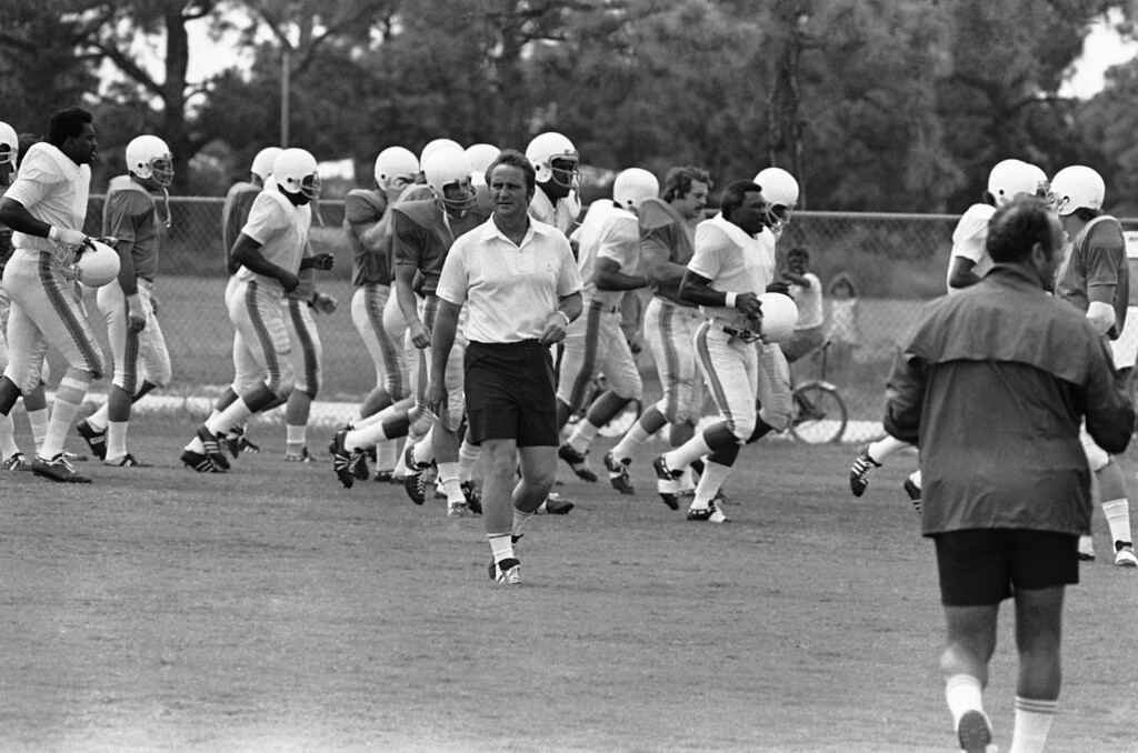 . Miami Dolphins coach Don Shula, front, runs a lap with the football club?s rookies as they shaped up in 78 degree heat at their Miami training camp on Friday, July 15, 1972 in Miami. The Dolphins began practice for the fall season last week. (AP Photo)