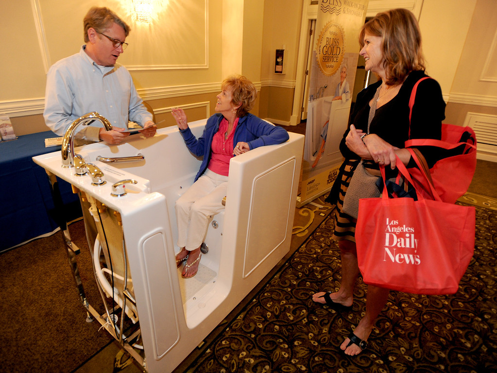 . (l-r) Hank Lambert from Bliss Walk-in Bathtubs talks to Carole Hester and her daughter Cindy Bond. The 4th annual Successful Aging Expo was held Saturday at the Sportsmen�s Lodge Events Center in Studio City, CA. 10/12/2013. photo by (John McCoy/Los Angeles Daily News)
