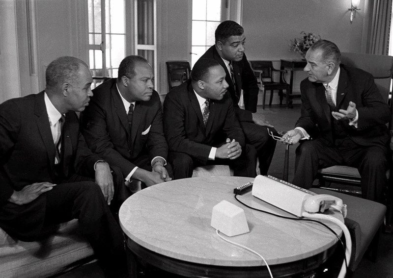 . President Lyndon B. Johnson talks with civil rights leaders in his White House office in this Jan. 18,1964 file photo. From left, are: Roy Wilkins, executve secretary National Association for the Advancement of Colored People; James Farmer, national director, Congress of Racial Equality; Dr. Martin Luther King Jr., head of the Southern Christian Leadership Conference; and Whitney Young, executive director of the Urban League. Farmer, who served alongside the civil rights giants of the 1950s and \'60s, died Friday, July 9, 1999. He was 79. (AP Photo/File)