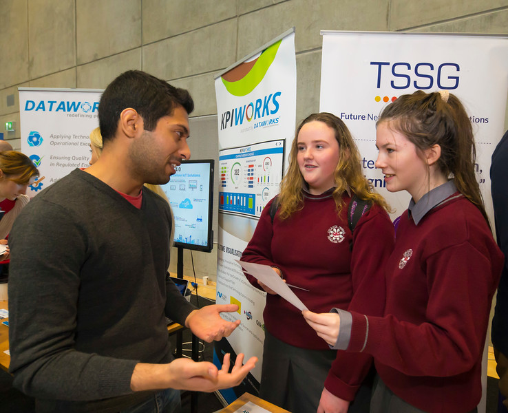 "09/11/2017. Crystal Valley Tech Showcase at WIT Arena. Pictured are Keely Cunningham and Alannah Szajda from St Declan's school, Kilmacthomas with Fayaz Akhtar of TSSG. Picture: Patrick Browne  Event demonstrates Tech and ICT is thriving in Waterford and the South East 50 companies and 2,000 students, industry and recruiters attend the inaugural Crystal Valley Tech Showcase event  Over 50 companies who are working together as Crystal Valley Tech showcased their rapidly growing industry in the WIT Arena on Thursday morning to approx. 2,000 members of the public, college and second level students, recruiters, government agencies and other industry.  The future is bright for ICT in the South East according to Dr Padraig Kirwan, Head of the Department of Computing & Mathematics at Waterford Institute of Technology. ""Computing is thriving in the South East judging by the number and diversity of ICT companies here today. Even more encouraging is the number of second level students who attended from Waterford, Kilkenny, Carlow, Tipperary and Wexford and how interested they are about the career opportunities in this exciting industry.""  Waterford schools attending the event included the Presentation Secondary School, St Angela's Secondary School, St Paul's Community College, and the Waterford College of Further Education from Water city, St Declan's Community College in Kilmacthomas, and Colaiste Chathail Naofa in Dungarvan.  Elaine Fennelly, Bluefin Payment Systems General Manager and co-founder of Crystal Valley Tech is very excited about the industry in the South East and today's showcase event. ""People who work in the industry already know that Tech is well established in the South East and the number of opportunities and companies continues to grow and grow. According to a recent Tech Ireland report there are over 60 indigenous and multinational companies employing well over 1,500 people from their bases in Waterford, Wexford, Kilkenny and Carlow.  ""How"