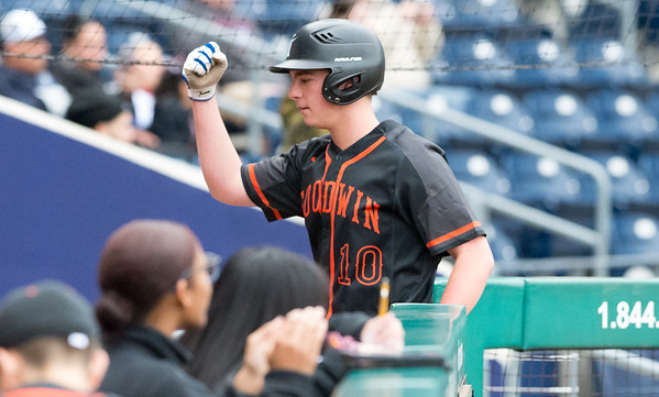 05/01/19 Wesley Bunnell | Staff Goodwin Tech baseball was defeated by Prince Tech on Wednesday evening at Dunkin Donuts Park in Hartford. Michael Lukaszewski (10) congratulated by teammates after he scored on a wild pitch from third.