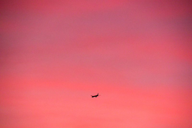 January 5 - Airplane descending to LAX for an early morning landing during sunrise.jpg