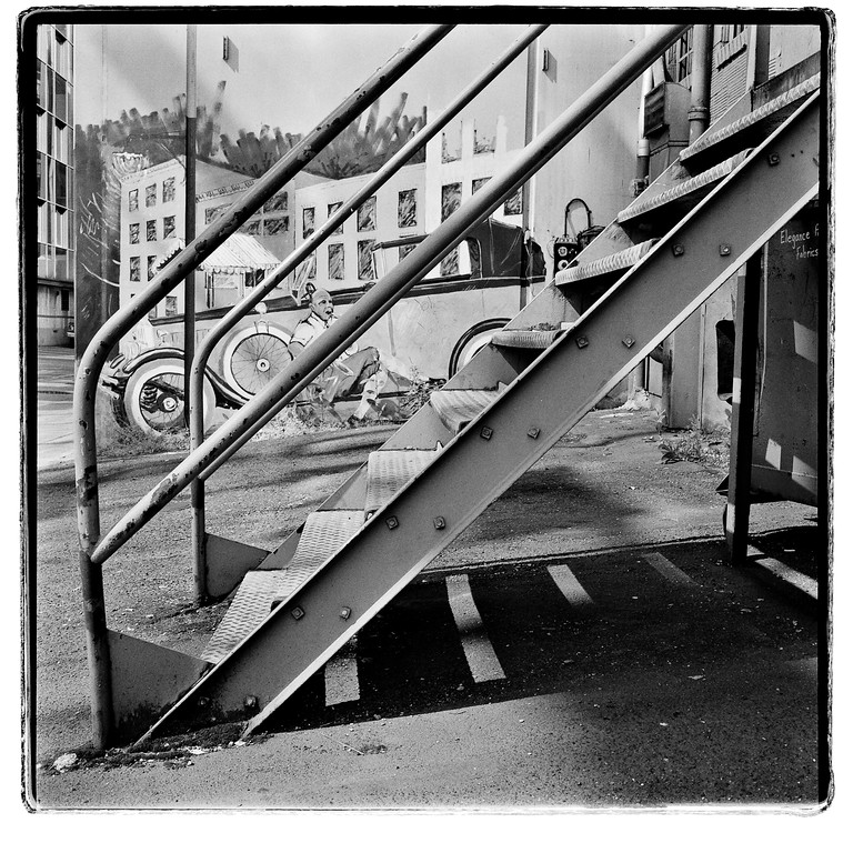 Stairway outside of a jazz club, Seattle, Washington, 1993.  HP5 Plus.