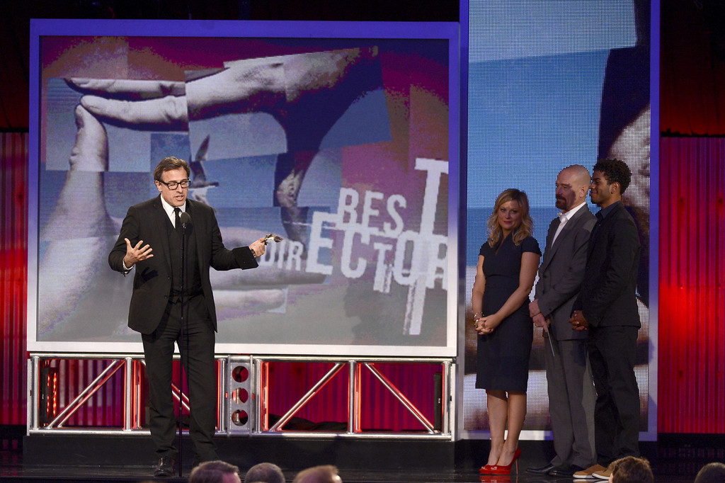 . SANTA MONICA, CA - FEBRUARY 23: Director David O. Russell accepts the Best Director award for \'Silver Linings Playbook\' from presenters Amy Poehler and Bryan Cranston onstage during the 2013 Film Independent Spirit Awards at Santa Monica Beach on February 23, 2013 in Santa Monica, California.  (Photo by Kevork Djansezian/Getty Images)