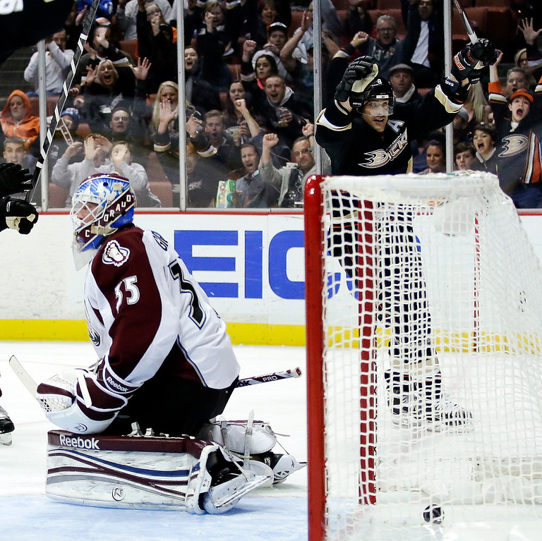 . Anaheim Ducks right wing Teemu Selanne, right, celebrates his goal past Colorado Avalanche goalie Jean-Sebastien Giguere during the second period of an NHL hockey game in Anaheim, Calif., Sunday, Feb. 24, 2013. (AP Photo/Chris Carlson)