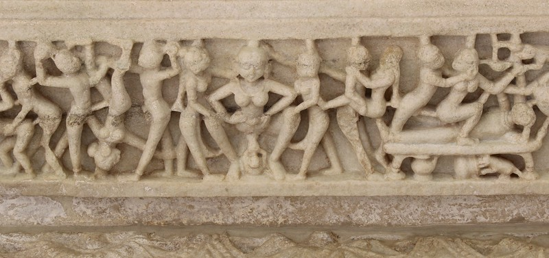 Notice at the center is a woman giving birth. Next to her notice the scenes of erotica. - Ranakpur Jain Temple