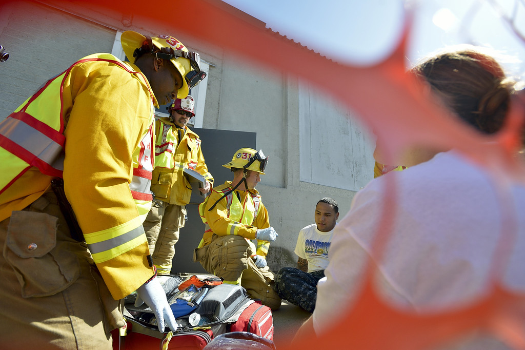 . SEAL BEACH, CALIF. USA -- Firefighters at Seal Beach Naval Weapons Station Seal Beach triage victims during an a active-shooter scenario drill on February 26, 2013.  Photo by Jeff Gritchen / Los Angeles Newspaper Group