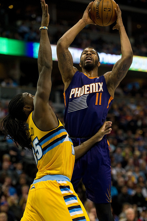 . DENVER, CO - DECEMBER 20: Markieff Morris #11 of the Phoenix Suns goes up for a shot against Kenneth Faried #35 of the Denver Nuggets during the fourth quarter of an NBA game at the Pepsi Center on December 20, 2013, in Denver, Colorado. The Suns won 103-99. (Photo by Daniel Petty/The Denver Post)