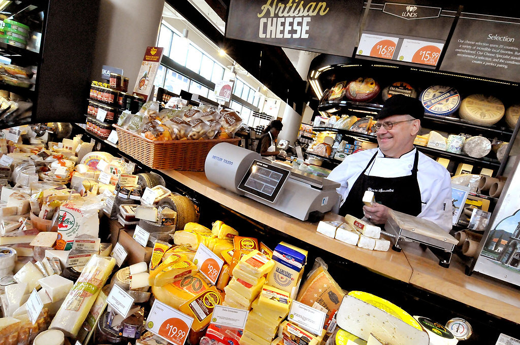 . Mike Brantl, a cheese specialist, works in the deli area at the downtown Minneapolis Lunds store.  (Pioneer Press: John Doman)