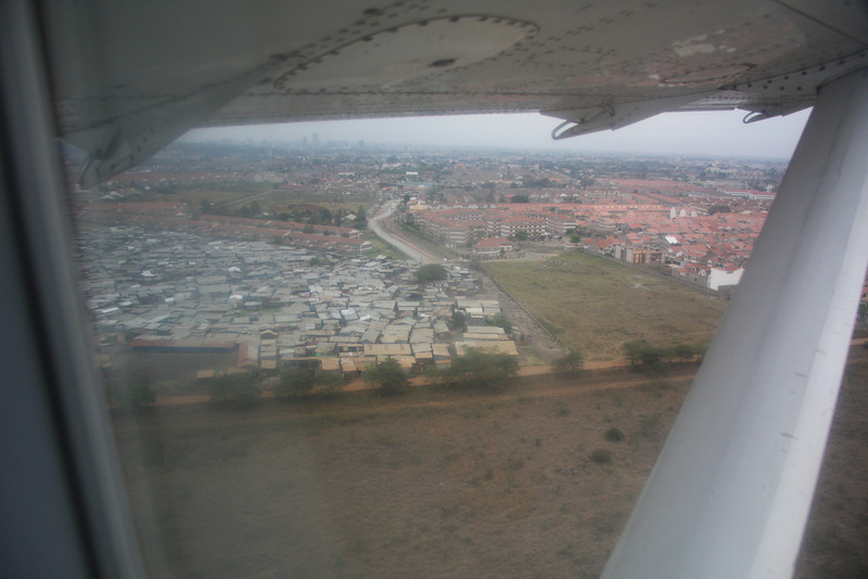 Departing Nairobi. On the left is part of the 2nd largest slum in Nairobi, home to over 800,000 people.