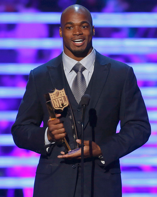 . Minnesota Vikings running back Adrian Peterson accepts the award for the NFL Fantasy Player of the Year during the NFL Honors award show in New Orleans, Louisiana February 2, 2013.    REUTERS/Jeff Haynes