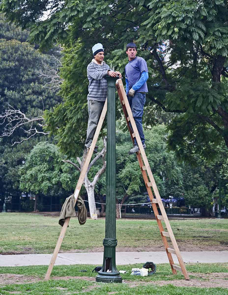 Lightpole repair men near the Recoleta Cemetery, Buenos Aires.