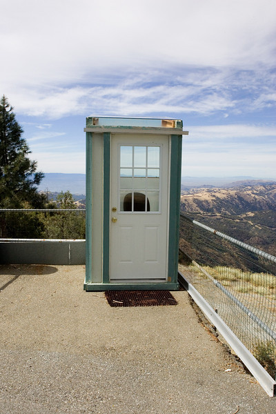 We found this small structure that looks suspiciously like an outhouse with a spectacular view.  Best guess is a weather observing station.  Notice that the roof is glass.