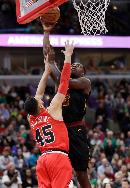. Cleveland Cavaliers forward Jeff Green, right, shoots against Chicago Bulls guard Denzel Valentine during the first half of an NBA basketball game Saturday, March 17, 2018, in Chicago. (AP Photo/Nam Y. Huh)