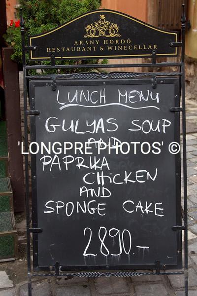 Sandwich board along Budapest sidewalk.
